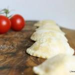 Tortelli  burrata e pomodorini confit con salsa al basilico